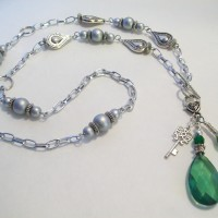 "An Emerald is the birthstone for May.  An elegant long 36"" length."