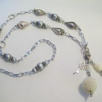 "A Pearl is the June Birthstone.  An elegant long 36"" length."